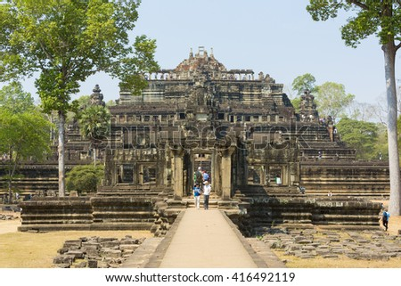 ANGKOR, CAMBODIA - FEBRUARY 2:  View of Baphuon Temple part of Angkor Thom complex with tourists visiting it.  Unesco Heritage site. Cambodia 2016.