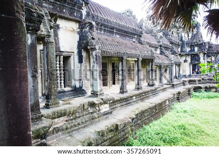Angkor Wat Cambodia. Khmer ancient Buddhist temple under the picturesque sky with clouds and sunlight. Famous landmark, place of worship in Asia. - stock photo