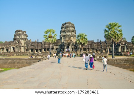 ANGKOR WAT - JAN ,4 : tourists at temple Angkor Wat on Jan 4,2014 in Siem Reap,Cambodia.Templ es of Angkor are the most famous attraction in Cambodia with more than 2 milion visitors per year. - stock photo