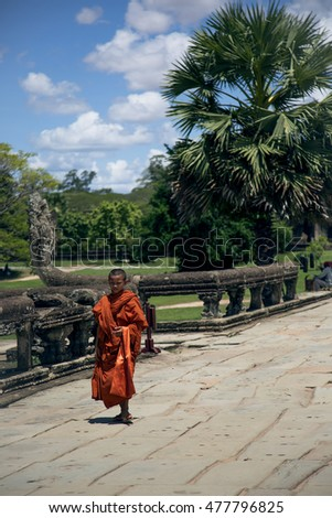 ANGKOR WAT - JULY 14: Young monk walks throught the main road in Angkor Wat on July 14, 2016 in Cambodia.