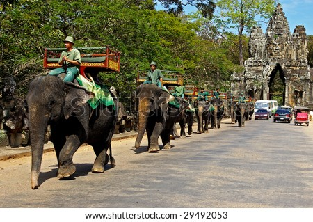 ANGKOR WAT - MARCH 17 : Elephant rides for tourists at Cambodia's most famous tourist attraction, the temple Angkor Wat March 17, 2009 in Siem Reap, Cambodia.