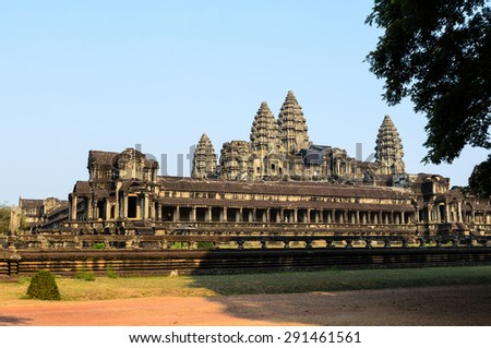 Angkor Wat, part of Khmer temple complex, popular among tourists ancient landmark and place of worship in Southeast Asia. Siem Reap, Cambodia. - stock photo