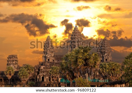 Angkor Wat temple with sunset sky and clouds - stock photo