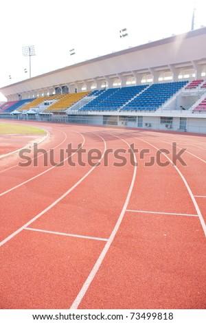Angle curve of the athletics track. Ahead fantastic. - stock photo