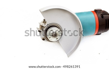 Angle Grinder with a protective casing on a background of white polystyrene