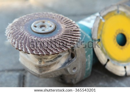 Angle grinder with  diamond blade for cutting tile and abrasive disk for grinder. - stock photo