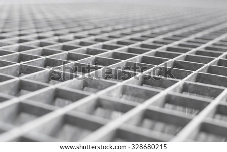 Angle metal lattice background with shallow DOF and selective focus point on small cells of grid - stock photo