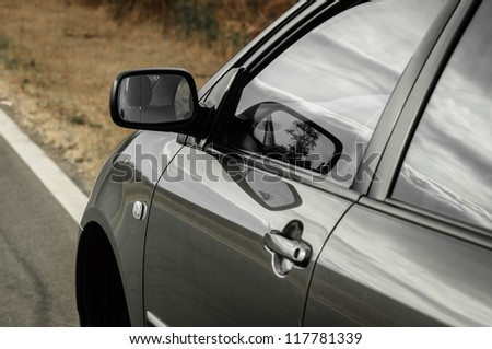 Angle shot of a car with reflection - stock photo