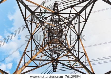 angle view of a power line with clouds in the background - stock photo