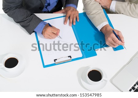 Angle view of business people developing the strategy of the company  - stock photo