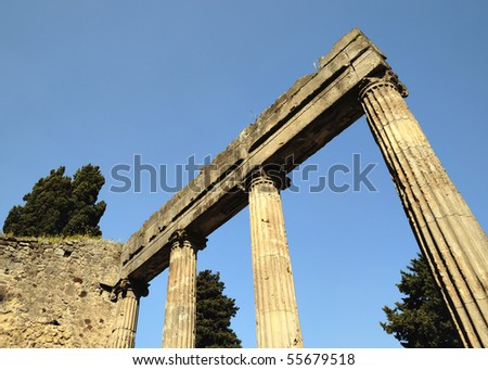Angle view of columns on entry of house in Pompeii, Italy
