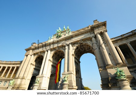 Angle view of The Triumphal Arch in Cinquantenaire Parc in Brussels in clear autumn day - stock photo