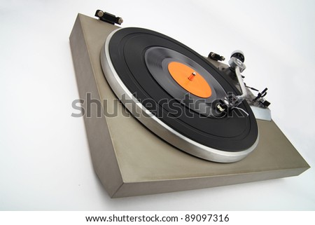 Angle view of vintage turntable with vinyl phonorecord