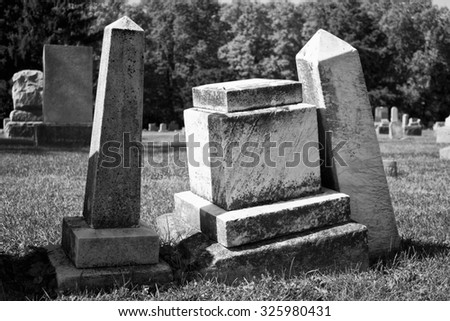 Angled Headstones - Angled and Aged Headstones from 19th Century - stock photo