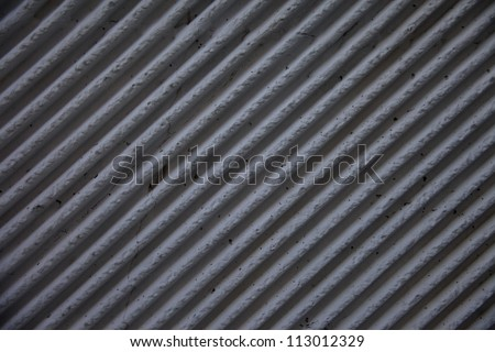 Angled lines on vintage concrete wall - stock photo