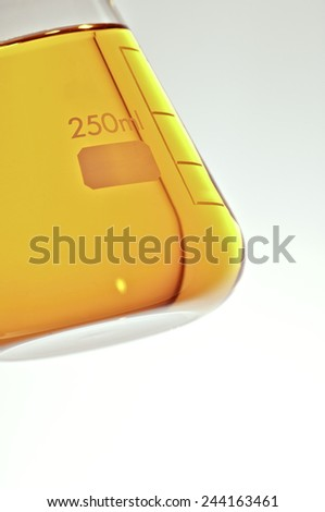 Angled view of a flask with yellow liquid - stock photo
