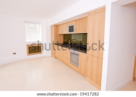 Angled View of Luxury Brand New Kitchen in Luxury Apartment