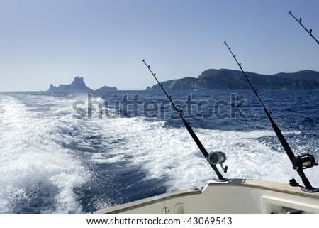 Angler boat big game fishing in saltwater ocean - stock photo