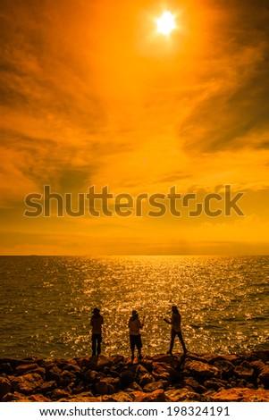 Angler fisherman and sunset - stock photo
