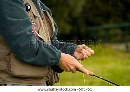 Angler, focus on body and rod - stock photo