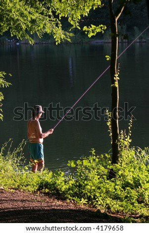 Angler with his fishing rod at beautiful lights