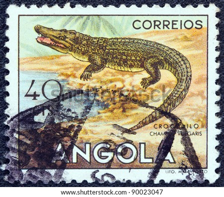 "ANGOLA - CIRCA 1953: A stamp printed in Angola from the ""Angolan fauna"" issue shows a crocodile, circa 1953."