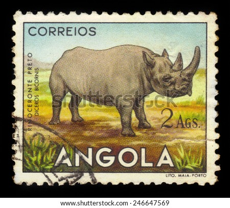 "ANGOLA - CIRCA 1953: A stamp printed in Angola shows a african rhinoceros, ""angolan fauna"" issue, circa 1953 - stock photo"