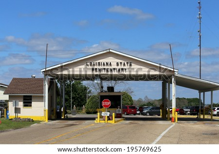 "ANGOLA, LA � APRIL 11: The Louisiana State Penitentiary located in Angola, Louisiana on April 11, 2014. The Louisiana State Penitentiary is a prison farm nicknamed the �Alcatraz of the South."" - stock photo"
