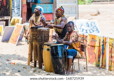 ANGOLA, LUANDA - MARCH 4, 2013: Local Angolan musicians make national sound with the drums in Angola, Mar 4, 2013. Music is one of the main African entertainments. - stock photo