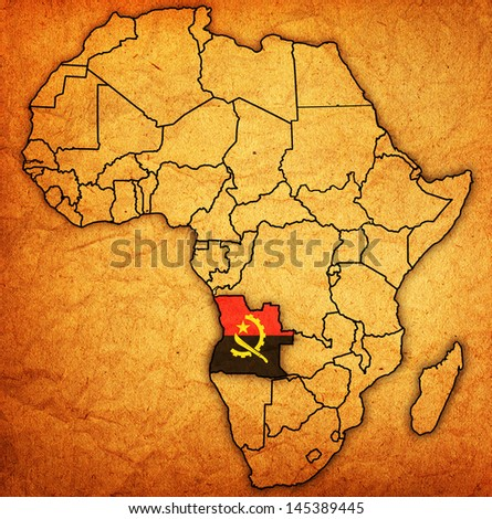 angola on actual vintage political map of africa with flags - stock photo