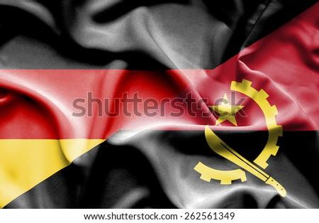 Angola waving flag Germany - stock photo