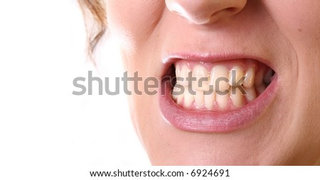 ANGRY A young angry woman is showing her teeth in anger! Isolated image over white with a lot of space left for text!