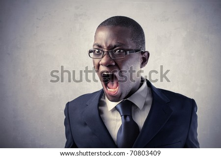 Angry african businessman shouting - stock photo