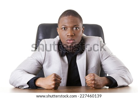 Angry african businessman shouting on someone - stock photo