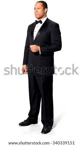 Angry African man with short black hair in evening outfit - Isolated