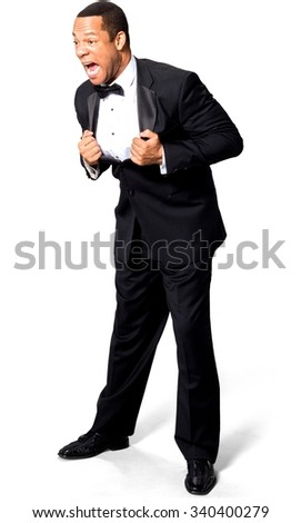 Angry African man with short black hair in evening outfit with hands holding lapels - Isolated