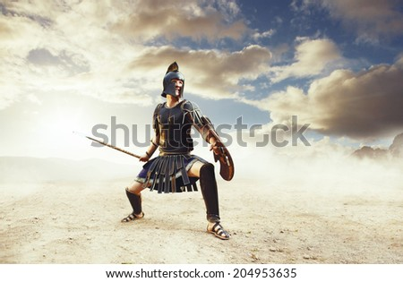 Angry ancient Greek warrior fighting in the combat - stock photo