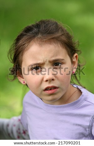 Angry and upset looking six year old child - stock photo