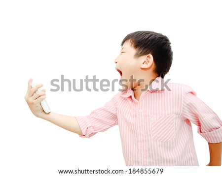 Angry Asian child shouting At Mobile Phone, isolated on white.