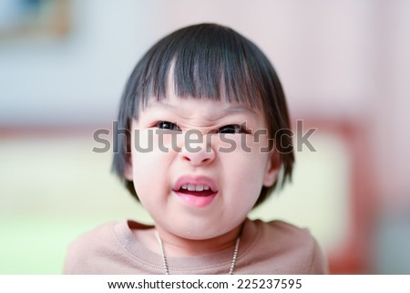 Angry Asian girl.