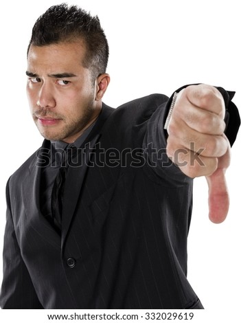 Angry Asian man with short black hair in business formal outfit giving thumbs down - Isolated