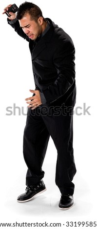 Angry Asian man with short black hair in business formal outfit holding mobile phone - Isolated