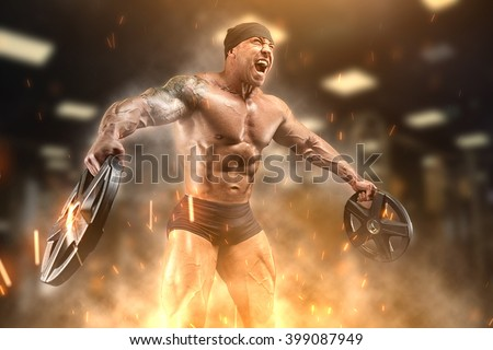 Angry athlete trains in the gym - stock photo