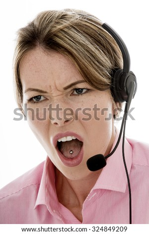 Angry Attractive Young Business Woman Using a Telephone Headset Making Sales Calls or Marketing Against a Plain White Background - stock photo