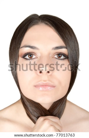 Angry beautiful brunette holding her long hair isolated on white - stock photo