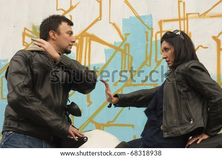 Angry Biker Girl Facing Motorcycle Man