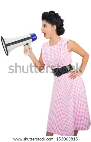 Angry black hair model shouting in a megaphone on white background - stock photo