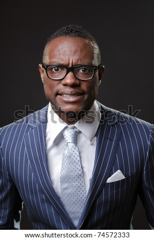 Angry black young business man screaming wearing suit and glasses. - stock photo