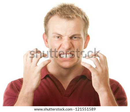 Angry blond muscular Caucasian man with clenched teeth