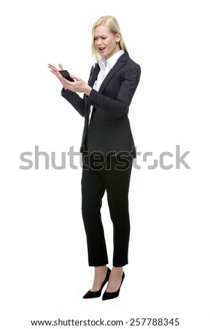 angry blonde businesswoman shouting at mobile phone - stock photo